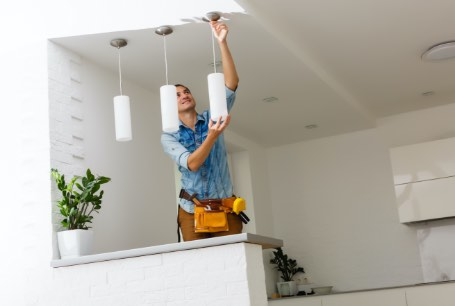 electrician changing light